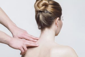 A woman getting a history about the benefits of Acupuncture