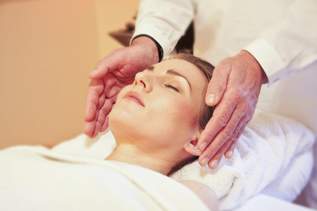 Woman receiving a Reiki treatment