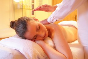 Woman relaxing during a Reiki treatment