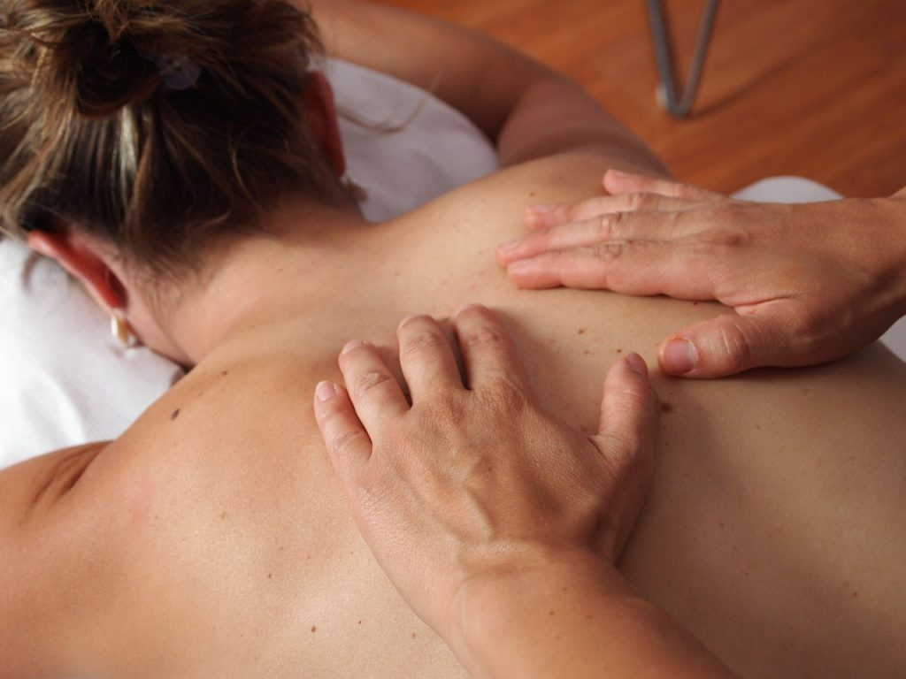 A woman getting a massage for Sciatica pain relief.